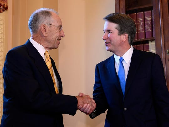 Supreme Court nominee Brett Kavanaugh, right, shakes hands with Sen. Chuck Grassley, R-Ia., left, on Capitol Hill in Washington, July 10, 2018.