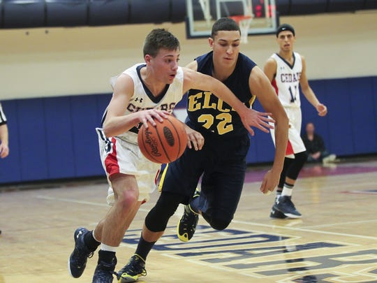Lebanon's Camryn Shaak drives past Elco's Nathan Beamer during the Cedars' 61-60 loss to Elco in the Lebanon Tip-off Tournament title game at Lebanon High School on Saturday.