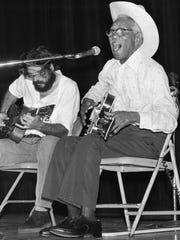 "Memphis blues musician Furry Lewis belts out a song during a performance at the Orpheum Theatre accompanied by Lee Baker on September 17, 1978. The concert, one in a series of Sunday afternoon blues concerts hosted at the Orpheum, coincided with the release of the Jim Dickinson produced album ""Beale Street Saturday Night"". The cost of admission was $2."