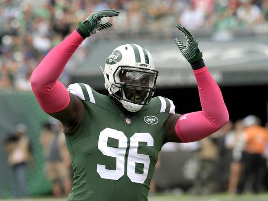 FILE - In this Sunday, Oct. 15, 2017 file photo, New York Jets defensive end Muhammad Wilkerson (96) reacts during the first half of an NFL football game against the New England Patriots in East Rutherford, N.J. New York Jets defensive end Muhammad Wilkerson was a full participant at practice after being benched at New Orleans on Sunday, Dec.17, 2017 but his playing status remains uncertain. (AP Photo/Bill Kostroun, File)