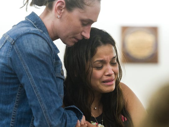 "In this file photo, Maria Rosales, whose husband Duilio Antonio ""Tony"" Rosales was fatally shot on the night of May 15, 2016, at a remote Excursion Inlet cabin near Juneau, Alaska, cries as she is escorted out of Juneau District Court. Former Arizona lawmaker Mark DeSimone was charged with first- and second-degree murder in connection with Rosales' death and his trial is set to begin Monday, April 23, 2018."