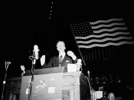 Billy Graham speaks at the opening of the annual Methodist camp meeting at Ocean Grove, N.J., Sept. 3, 1955. A record-breaking audience of 12,000 packed the vast auditorium and nearby camp meeting buildings where loudspeakers were installed.