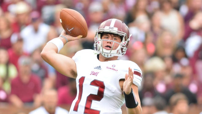 Quarterback Brandon Silvers (12) and Troy are poised to make the jump from the Sun Belt's middle of the pack in 2016.