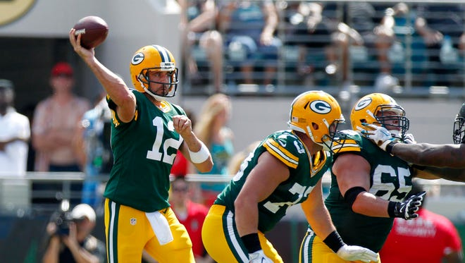 Green Bay Packers quarterback Aaron Rodgers (12) looks to pass against the Jacksonville Jaguars.