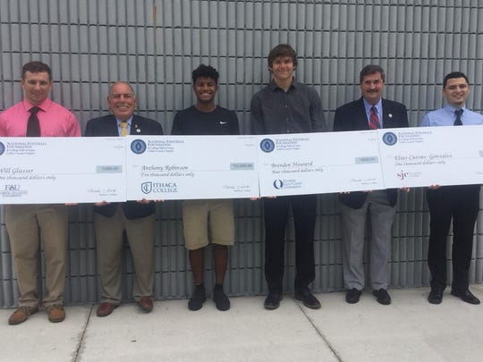 The winners of the National Football Foundation Collier County Chapter's 2018 scholarships display their ceremonial checks. From left: St. John Neumann's Will Glasser, chapter president Matt Sellitto, Golden Gate's Anthony Robinson, Marco Island Academy's Brenden Howard, chapter secretary Tom Stuart, Immokalee's Elias Cuevas.