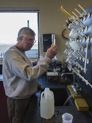 Mike Swindell tests stormwater runoff at Burlington's