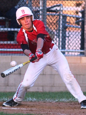 Beechwood senior Grant Plageman connects on a base hit to right field to drive in the first run of the game Wednesday in a 5-1 victory over Bishop Brossart in an All 'A' sectional.