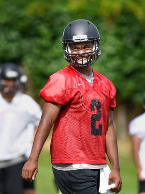St. Cloud State University quarterback Dwayne Lawhorn at practice Thursday, Aug. 10, at Husky Stadium