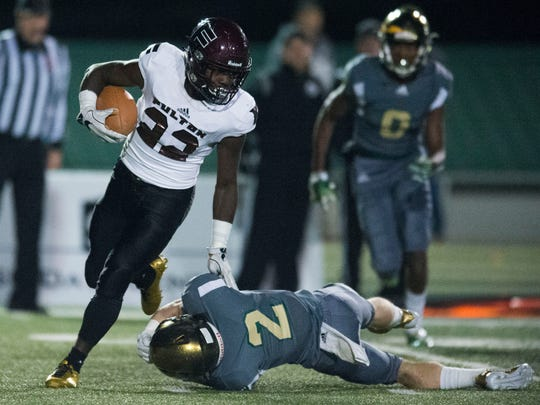 Fulton's Jashaun Fenderson gets past Knoxville Catholic's Taylor Shannon on a 90 yard touchdown run against Knoxville Catholic on Friday, November 10, 2017.