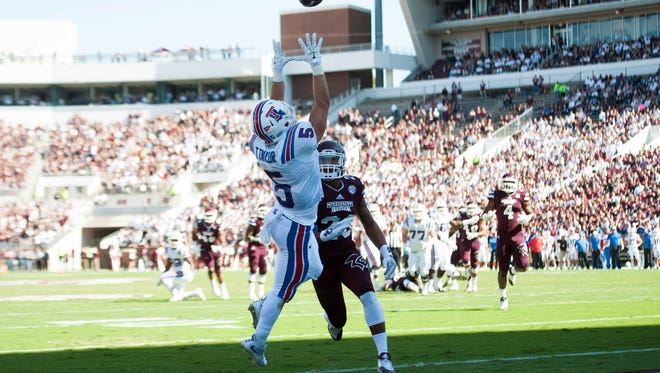 Louisiana Tech wide receiver Trent Taylor (5) jumps over Mississippi State defensive back Brandon Bryant (20) to catch a pass in the end zone last month in Starkville.