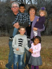Cancer survivor Sheridy Walker, standing top right, and her husband Mike with their four grandchildren: clockwise from bottom left, Remington, 7; Kasen, 3; Woodlynne, 2; and Shia, 4. Walker lives in Aztec, N.M.