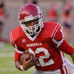 Lee's Michael Huntley (12) during their game with Lanier at Cramton Bowl on Thursday, Aug. 21, 2014.
