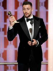Aaron Taylor-Johnson accepts his award for best supporting