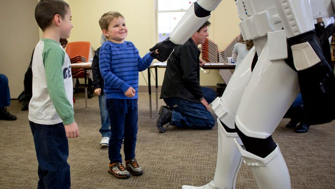 Tristan Bowden, 4, of Marine City, reacts as he shakes hands with a Storm Trooper during a meet-and-greet with Star Wars characters Saturday, November 21, 2015 at the Marine City Public Library.