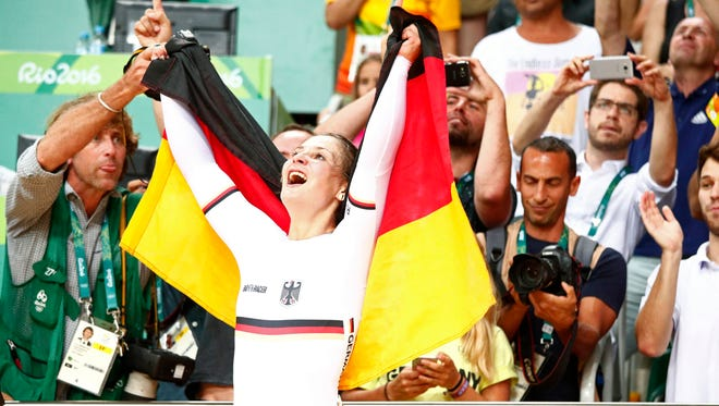 Kristina Vogel (GER) celebrates winning the gold medal during the women's sprint finals in the Rio 2016 Summer Olympic Games at Rio Olympic Velodrome.