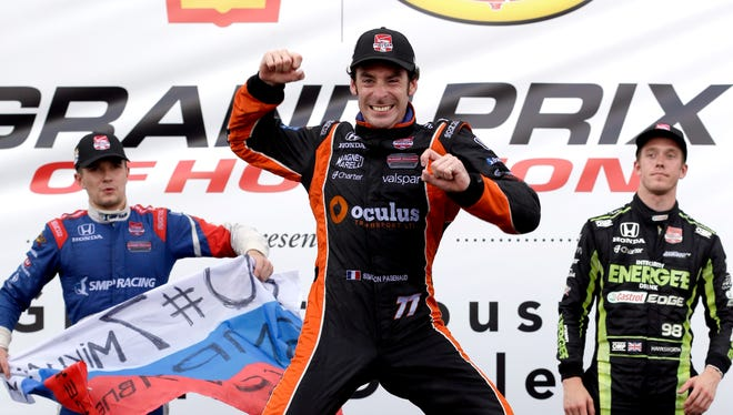 Simon Pagenaud, center, celebrates his victory after the secondr race of the Grand Prix of Houston doubleheader on Sunday. Joining him on the podium are second-place finisher Mikhail Aleshin, left, and third-place finisher Jack Hawksworth.