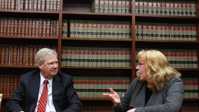 David Wheaton, secretary and treasurer of Levinson Axelrod, and Dr. Rosemary McGeady, an attorney with the firm, talk in the Edison office about the firm's 75th year anniversary.