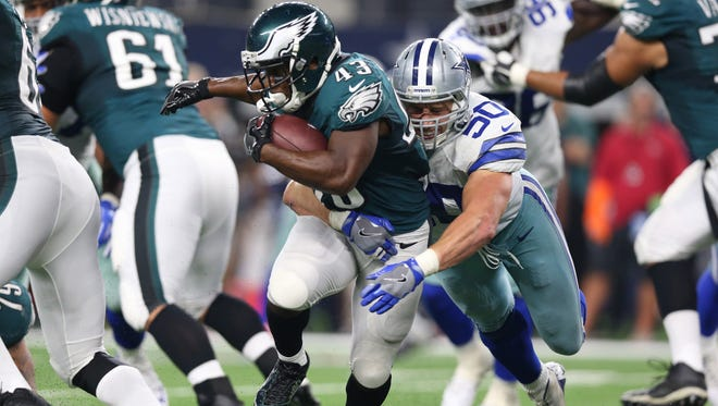 Philadelphia Eagles running back Darren Sproles (43) is tackled for a loss in the third quarter agaisnt Dallas Cowboys linebacker Sean Lee (50) at AT&T Stadium.