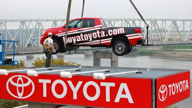 Workers removing a Toyota Tundra from center field perch at Great American Ball Park.