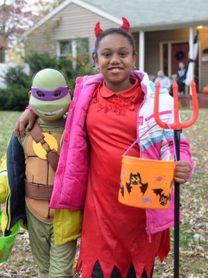 Jesus Quintanez, 7, and his sister Cielo Quintanez, 9, of Vineland, trick-or-treated along Grandview Avenue in Vineland last year.