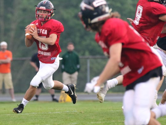 Crestview's Jay Oswalt looks to make a pass during the North Central Ohio All-Star Football Classic at Lexington High School on Friday.
