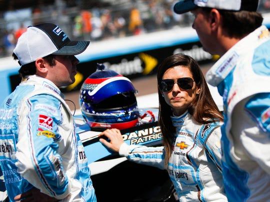 Driver Danica Patrick talks to crew members before