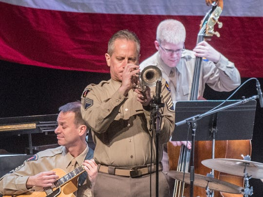 Chief Master Sgt. Kevin R. Burns plays trumpet as the Airmen of Note perform for Montgomery's annual Glenn Miller Holiday Concert at Troy University's Davis Theatre on Wednesday, Dec. 13, 2017.