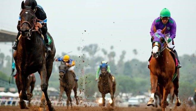 Shared Belief runs past California Chrome in Saturday's San Antonio Stakes.