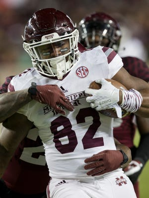 Mississippi State tight end Farrod Green (82) is brought down by Texas A&M defensive back Armani Watts (23) after a catch and run for a first down during the third quarter of an NCAA college football game on Saturday, Oct. 28, 2017, in College Station, Texas. (AP Photo/Sam Craft)