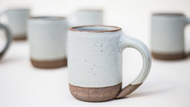 Local, handmade mugs like these, along with matching plates and other dinnerware will be available at a new space downtown this weekend.