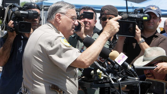 Sheriff Joe Arpaio shown with a few of the people who need him.