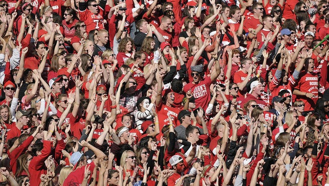 Fans in the student section at Clemens Stadium cheer during the St. John's University vs. St. Thomas game in 2010. An NCAA Division III record crowd of 16,421 attended.