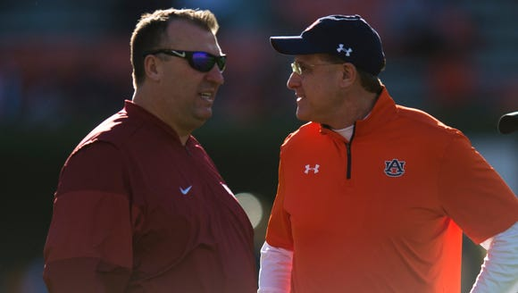 Arkansas head coach Brett Bielema greets Auburn head