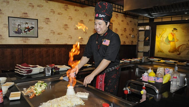 Hibachi chefs often use fire while preparing food and performing for clients at Fuji Steakhouse in Waite Park.