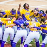 LSU shortstop junior shortstop Bianka Bell (center) leads a chant after the Tigers' 4-3 regional win over Arizona State Sunday. Bell, the team's emotional leader all season, hit a game-winning, walk-off single in the ninth inning.