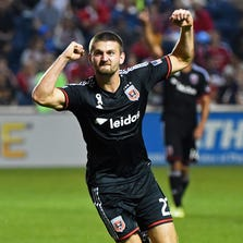 Sep 20, 2014; Chicago, IL, USA;  D.C. United midfielder/defender Perry Kitchen (23) reacts after scoring a goal against the Chicago Fire during the second half at Toyota Park. The Chicago Fire and D.C. United end in a draw 3-3. Mandatory Credit: Mike DiNovo-USA TODAY Sports