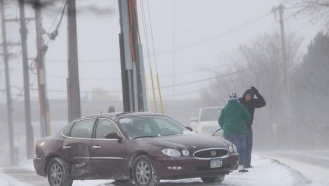 A driver exits the car on the curve at South Clinton Avenue and Westfall Road after an accident on Jan. 7.