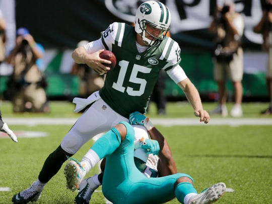 New York Jets' Josh McCown (15) is sacked by Miami Dolphins' Cameron Wake (91) during the first half of an NFL football game Sunday, Sept. 24, 2017, in East Rutherford, N.J. (AP Photo/Seth Wenig)