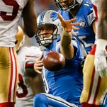 Detroit Lions quarterback Matthew Stafford huddles with his team against the St. Louis Rams on Dec. 13, 2015, in St. Louis.