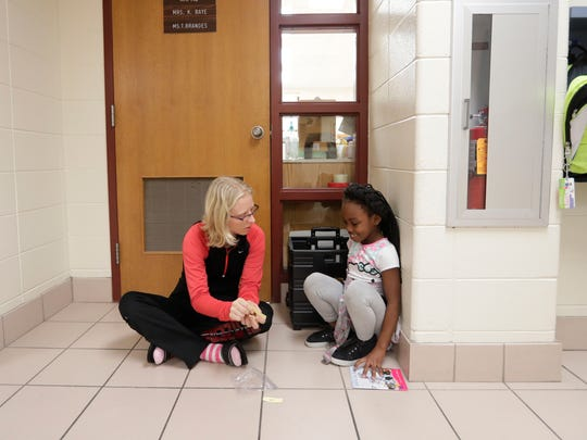 Wilder Elementary School and their neighbor, NEW Lutheran High School, have formed a reading program that brings the older students into elementary classrooms to work on reading skills. MarKee Hatcher and tutor Madison Olp work together in a quiet spot September 28, 2016