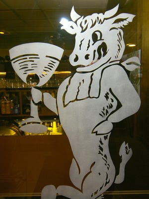 A bull, symbol of the eatery, is etched on the door of Maury's TIny Cove in Cheviot.