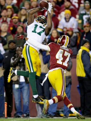 Green Bay Packers receiver Davante Adams catches a  second quarter pass over the defense of Washington Redskins defensive back Quinton Dunbar.