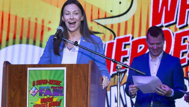 Florida Agriculture Commissioner Nikki Fried speaks next to WPTV's Jay Cashmere during Opening Day at the South Florida Fair, January 18, 2019.