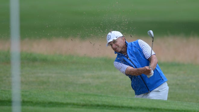 Ron Gigliodoro blasts out of a bunker on the 18th hole at Potowomut Golf Club during Monday's Four Ball Championship.