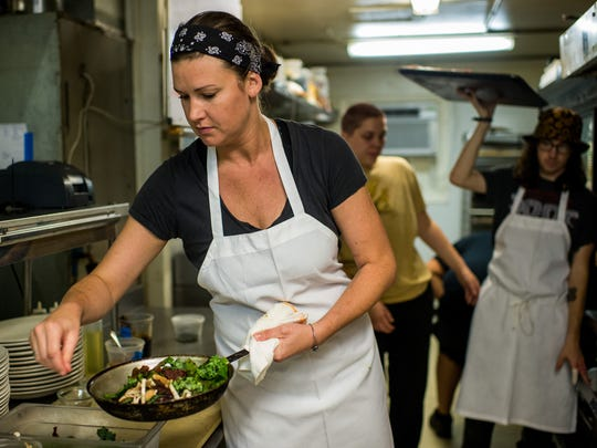 Ashley Roussel, executive chef of the Saint Street Inn, plates a dish in the restaurant's kitchen in Lafayette, La., Friday, Oct. 30, 2015.