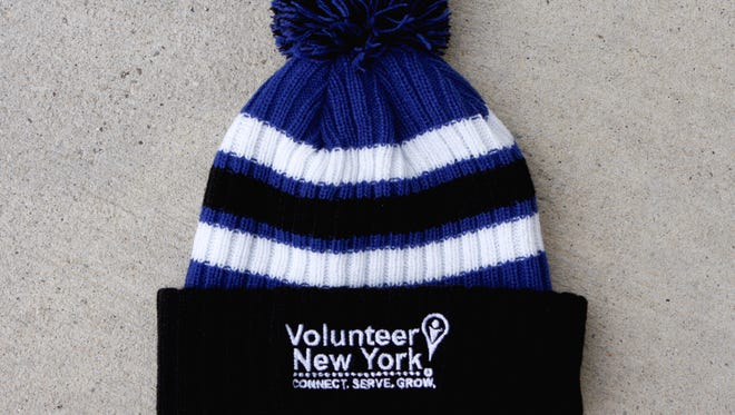 The first 50 local business leaders to pledge a Giving Tuesday donation of $500 will receive this Volunteer New York! hat.