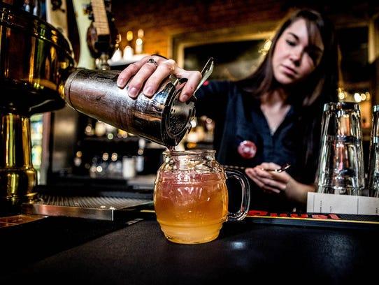 Carly Shaw of Granville mixes  Bumble Bee Lemonade,