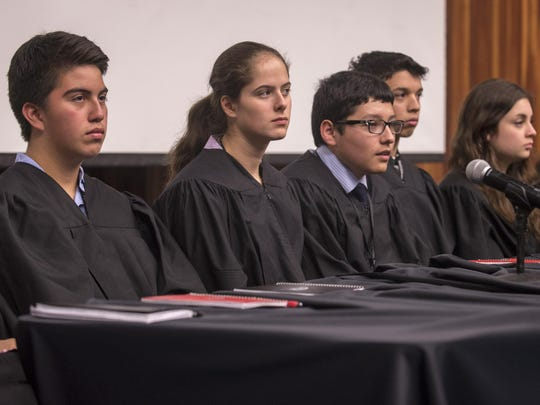 Students in the 2015 New York Lorenzo De Zavala Youth Legislative Session play the part of Supreme Court Justices in a mock government proceeding held at the University of Rochester Friday.