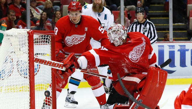 Red Wings goalie Jimmy Howard reaches back to block a Sharks shot at the end of the second period Oct. 22, 2016 at Joe Louis Arena.