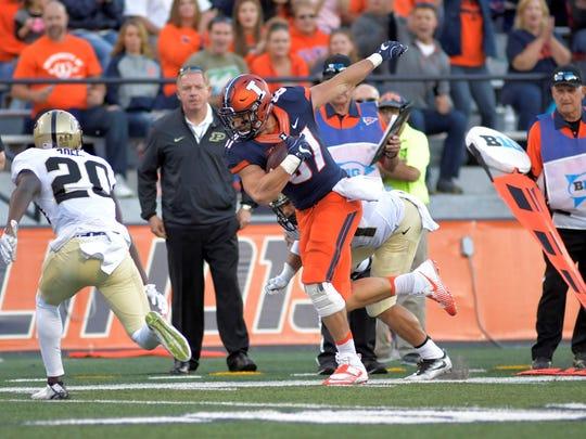 Illini tight end Tyler White runs against Western Michigan in the Broncos' 34-10 win Sept. 17 in Champaign, Ill.